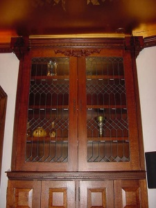 Gorgeous dark wood & leaded glass fronts. BYOB 😜