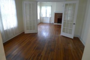 BEFORE: gorgeous hardwood floors at this historic home at 1015 N. Fowler in Palestine. House home for sale in Palestine Texas by Lisa Priest Real Estate Agent with Picket Fence Realty.