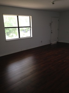 What a difference!  Out with the old carpet, in with the fresh paint and gorgeous floors!