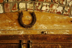 A horseshoe over the door for luck is an old tradition that is still in widespread practice today!  Image: Helen Cook via Flickr