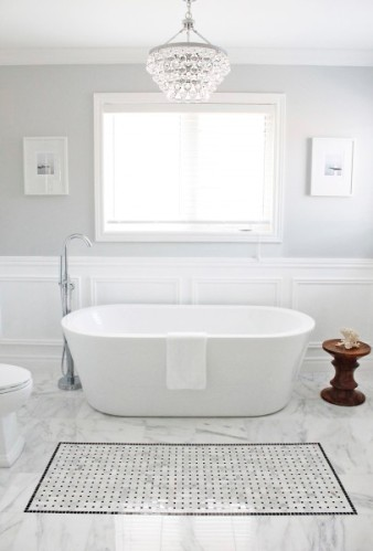 "Bubble Bath? Don't mind if I do! Who wouldn't want to bathe here?! Another gorgeous grey from Valspar called ""Polar Star."" Love it!  Image: Involving Color"